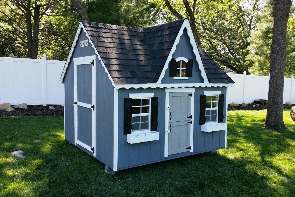 Victorian playhouse in Long Island backyard.